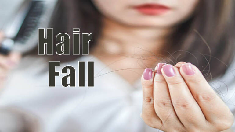 Women hairfall while combing hair