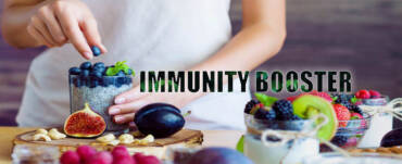 Immunity booster with fruits like grapes, cashew, strawberry serving by lady