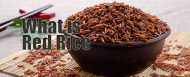 Red rice in a bowl and garnished in mat