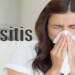 Sinusitis women sneezing with tissue in hand